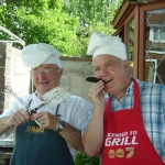 The mad chefs, Paul Webster and Howard Johnson, ready for a grilling at an SDFM BBQ social.