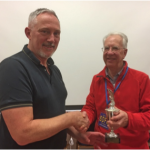 Alan Cross receiving the Ferring Cup trophy from Bob Summers
